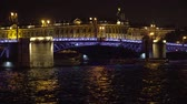 petersburg : Bridge over the river, illuminating the water with light from lampposts. City night scene with illuminated drawbridge over river.Saint Petersburg,Russia.