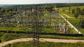 tensão : Aerial view Power plant, transformation station, cables and wires. High voltage electric power substation. Electrical power transformer in high voltage substation, 4K, aerial footage.