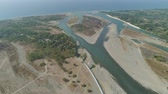 záliv : Aerial view of rver flowing into the sea in Philippines,Luzon. ropical landscape with sandy coast and river among farmer fields flowing into the blue ocean