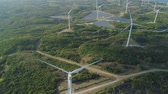 bangui : Aerial view of Windmills for electric power production. Bangui Windmills in Ilocos Norte, Philippines. Solar farm, Solar power station. Stock Footage