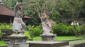 sassi : Hindu temple with statues of the gods on Bali island, Water Palace Tirta Gangga, Indonesia. Balinese Hindu Temple, old hindu architecture, Bali Architecture, Ancient design Filmati Stock