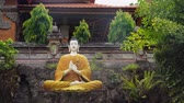 budizm : Statue of the Buddhist God Buddha in the Buddhist temple Brahma Vihara Arama with statues of the gods on Bali island, Indonesia. Bali Architecture, Ancient design. Travel concept.