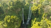 flowing water : Waterfall in green rainforest. Aerial view of triple waterfall Sekumpul in the mountain jungle. Bali,Indonesia. Travel concept. Aerial footage.