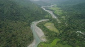 ryż : Aerial view of mountain valley in the cordillera, river, rice terraces, farmland in the Philippines, Luzon. Aerial view of mountains covered forest, tree. Cordillera region. Wideo