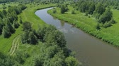 wood stream : Aerial view summer landscape, river among trees. Countryside, the banks of the river are covered with greenery, reflection of clouds onwater surface