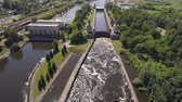 montáž : Sluice Gates on the River. Aerial view river sluice construction, water river gateway. Shipping channel on the river.