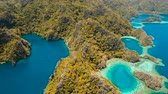 busuanga : Aerial view: Lagoon with blue, azure water in the middle of small islands and rocks. Beach, tropical island, sea bay and lagoon, mountains with forest, Palawan, Coron. Busuanga. Seascape, tropical landscape. Aerial video. Philippines. 4K video Travel conc Stock Footage