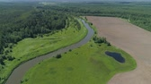 wood stream : Aerial view summer landscape, river among trees, farmlands. Countryside with forest, the banks river covered with greenery.