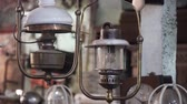 prąd : An old, vintage lamp with a shade in an antique store. Wideo