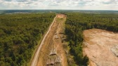 épít : Construction of a new road in the forest area. Aerial view construction road place. 4K, flying video, aerial footage