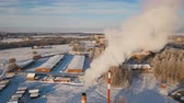 electricity pole : Boiler room in the winter season, from the chimneys rise up clouds of steam. Pipes of a thermal power plant. Boiler house, pipe plant, boiler plant. Aerial footage, 4K video.