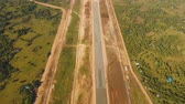montáž : aerial footage construction new airport terminal on Panglao Philippines. Construction of a landing strip. Landing strip.