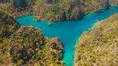 ostrov : aerial footage mountain lake Kayangan with turquoise water among the high rocks on a tropical island. Palawan, Philippines Travel concept