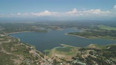 flor de loto : Aerial view of Paoay Lake with water lilies, Philippines. Lake against background of mountains and sky with clouds. Paoay Lake National Park, Ilocos Norte.