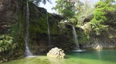 cachoeira : Waterfall in green rainforest. Bolinao waterfall in the mountain jungle. Philippines, Luzon. Travel concept.