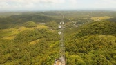 transmissor : aerial footage telecommunication tower located located in mountainous province. cellphone tower in rainforest white telecom radio tower
