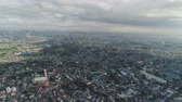 láthatár : Aerial view of Manila city with skyscrapers and buildings. Philippines, Luzon. Aerial skyline of Manila. Stock mozgókép
