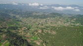 collines : Aerial view of rice terraces and agricultural farm land on the slopes of mountains valley. Cultivation of agricultural products in mountain province. Mountains covered forest, trees. Cordillera region. Luzon, Philippines, Baguio province. Vidéos Libres De Droits