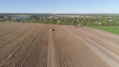 farming machinery : aerial potatoes harvesting machine with tractor in farm land for harvesting potatoes. Farm machinery harvesting potatoes.