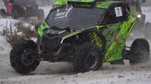 Sports competition Russia on ATV January 27, 2018: Winter racing atv, side-by-side vehicles. Rally on the buggy on the snow on a winter day. Racing in the SXS class. Off Road Series racing. 動画素材