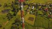 telekomünikasyon : Aerial view Cell phone tower. Tower of communications with lot of different antennas. Telecommunication tower. Aerial footage, 4K video