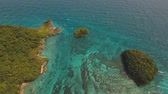 lagune : aerial footage lagoon with turquoise water and stony islands in tropical resort.