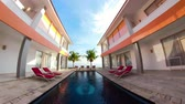 à beira da piscina : swimming pool in luxury hotel with sun beds by sea. tropical resort with pool. Travel concept.