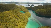 aerial footage cove with blue sea between tropical islands. Tropical landscape bay azure water lagoon Sugba philippines, siargao Travel concept