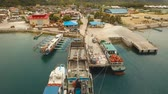 aerial footage cargo and passenger port with barges and cargo ships Dapa city, Siargao, Philippines. passenger ferry terminal