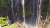 palmeiras : aerial view waterfall coban sewu in Java, indonesia. waterfall in tropical forest by drone Tumpak Sewu aerial footage
