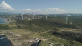 bangui : Aerial view of Windmills for electric power production on the coast. Bangui Windmills in Ilocos Norte, Philippines. Ecological landscape: Windmills, sea, mountains. Pagudpud Stock Footage