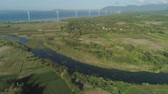 bangui : Aerial view of Windmills for electric power production on the seashore. Bangui Windmills in Ilocos Norte, Philippines. Ecological landscape: Windmills, sea, mountains. Pagudpud