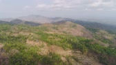 vale : mountain landscape high cliffs mountains covered with green tropical forest. aerial view mountain forest with large trees and green grass. tropical landscape in asia Jawa, Indonesia