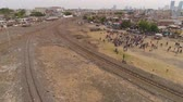 koets : aerial view poor district in indonesia with houses locals near railway, railway station in an asian city among buildings. Stockvideo