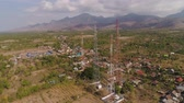 transmitir : aerial view cell phone towers line in bali, indonesia. Telecommunication tower, communication antenna on coast sea Stock Footage