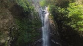 kaluž : aerial view waterfall in green rainforest. tropical waterfall in mountain jungle. Bali,Indonesia. Travel concept.