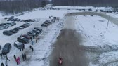 Russia, Championship on snowmobiles January 27, 2018: Winter racing on snowmobiles. Aerial view: Snowmobile on the route in a jump. Action from snowmobile races.