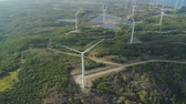 bangui : Aerial view windmills for electric power production. Bangui Windmills in Ilocos Norte, Philippines. Solar farm, Solar power station. Stock Footage