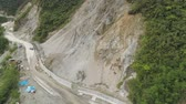 macchinari : Construction protective barriers against rock falls and landslides in mountainous province. Aerial view heavy machinery on the construction of a mountain road. Cement block road protection from landslides. Philippines, Luzon, North Batad.