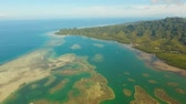 ラグーン : aerial footage seascape in lagoon with turquoise water, coral reef blue sea flying over the azure surface ocean. Travel concept 動画素材