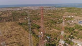 netwerken : aerial view cell phone towers line in bali, indonesia. Telecommunication tower, communication antenna on coast sea Stockvideo