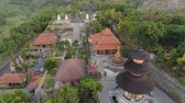 仏教徒 : buddhist temple Brahma Vihara Arama with statues gods. aerial view balinese temple, old hindu architecture, Bali architecture, ancient design. Travel concept. indonesia 動画素材