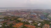 containerschip : aerial view container terminal port surabaya. cargo industrial port with containers, crane. Tanjung Perak, indonesia. logistic import export and transport industry Stockvideo