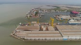 containerschip : aerial view cargo and passenger seaport with ships and crane Tanjung Perak, surabaya, indonesia. docks for the repair and parking of ships, cargo port and container terminal. ship in industrial port
