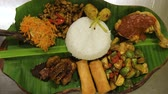 짜릿한 : indonesian fried chicken rice with sambal belacan on banana leaf. Indonesian food nasi ayam penyet, 무비클립
