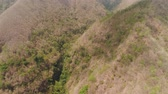 wachlarz : aerial view slopes mountains covered with forest and vegetation. mountain hilly landscape in asia. tropical landscape