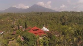 발리 : buddhist temple Vihara Dharma Giri with sleeping buddha. aerial view buddhist temple in mountains Bali Travel concept. indonesia 무비클립