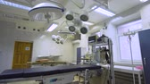 operating table : Operating room with equipment and medical devices in a veterinary clinic. Table for surgical operations in the hospital. Interior of operating room in modern clinic. Stock Footage