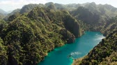 ráj : Aerial drone Kayangan lake with blue water on tropical island Coron. Lake in the mountains covered with tropical forest. Palawan, Philippines Dostupné videozáznamy