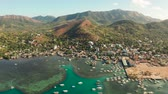 busuanga : Aerial view Coron city with slums and poor district. sea port, pier, cityscape Coron town with boats on Busuanga island, Philippines, Palawan. Seascape with mountains.